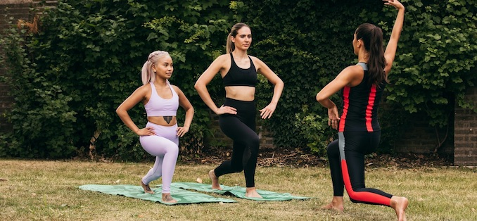 Group of people working out in a park
